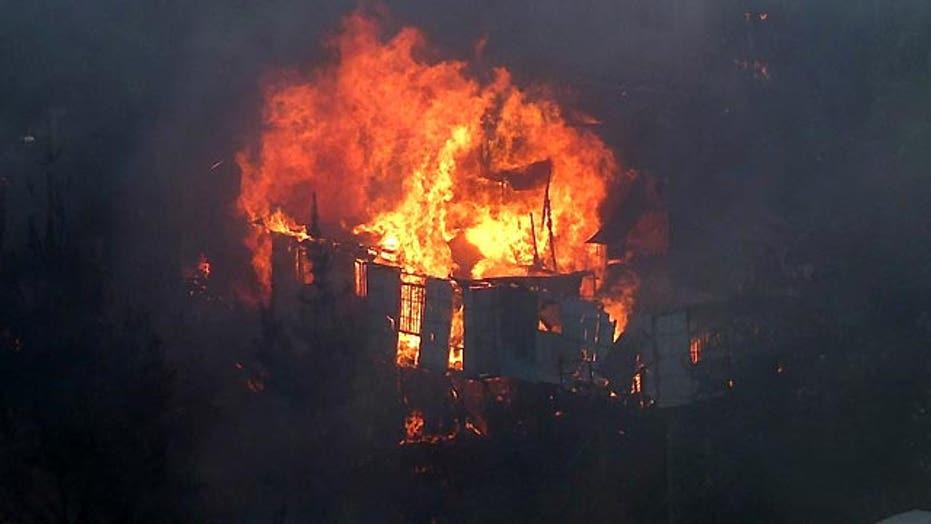 Around the World: Huge forest fire destroys dozens of homes
