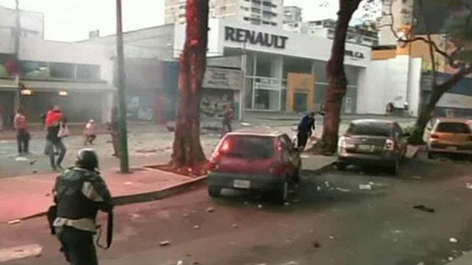 Venezuela expels 3 US embassy officials amid protests
