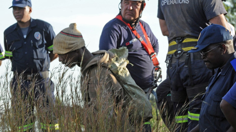 Illegal miners trapped in South Africa refuse to be rescued