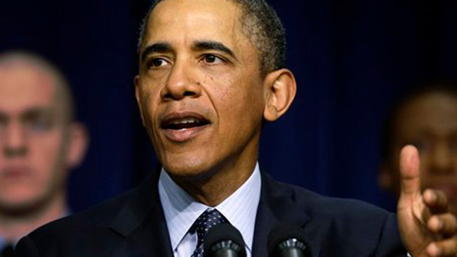 Obama warns of doom and gloom as spending cuts near