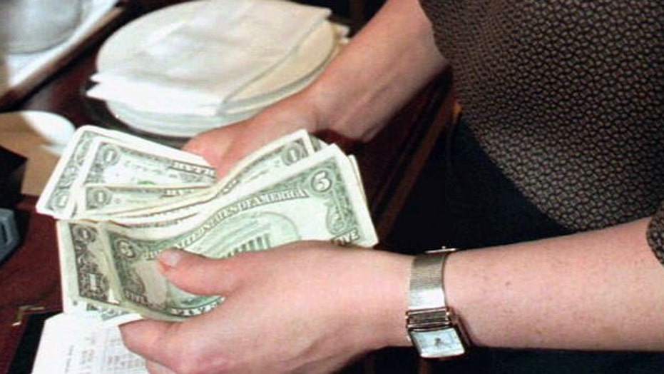 CBO: Wage hike would lift pay but cost jobs