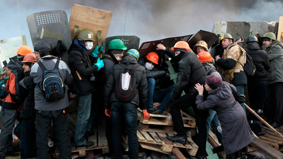 Protesters fight for position against riot police in Kiev