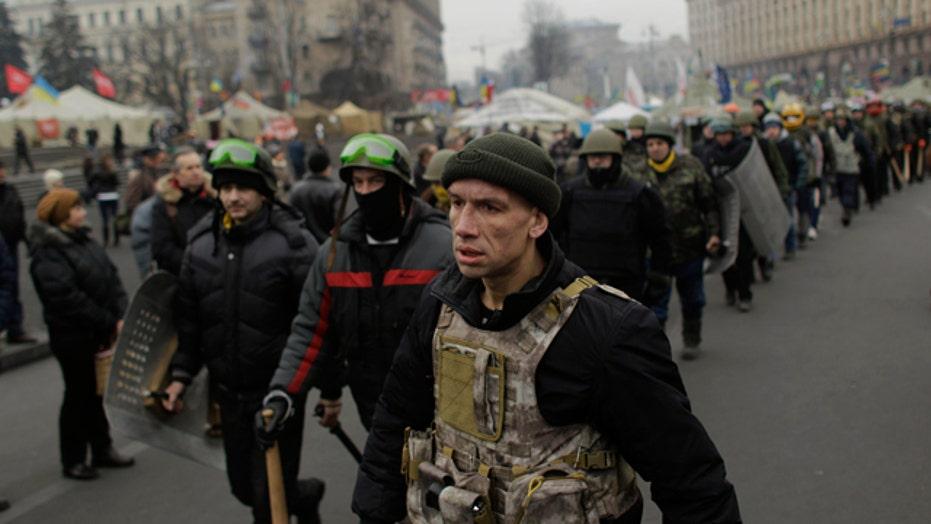 Ukraine's future in flux as protesters remain in Kiev