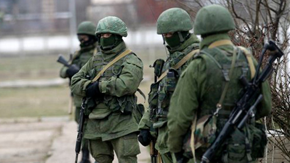 World looks for solution as Russia tightens grip on Crimea