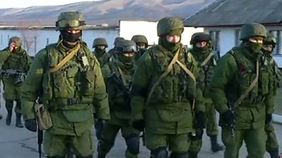 Russia floods Crimea with troops, denies issuing 'ultimatum'
