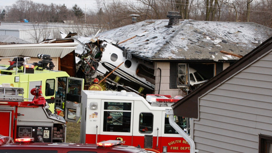Plane crashes into homes, kills 2