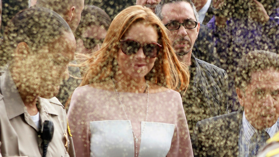 'Glitter-bomb' greeting for Lindsay Lohan at court arrival