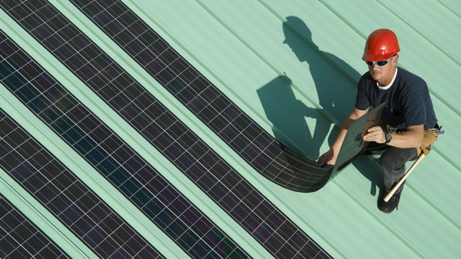 Solar energy firm lays off workers as it gets gov't loans