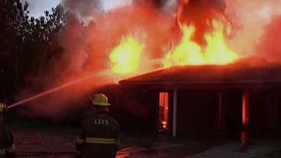 Homeowner sets snake on fire, burns down home