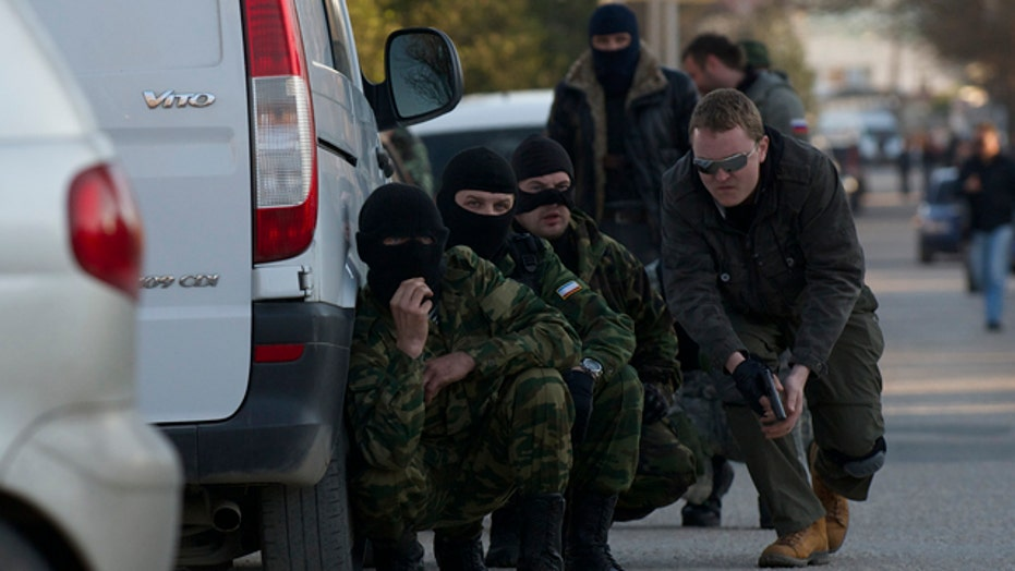 Pro-Russian forces storm Ukrainian base in Crimea