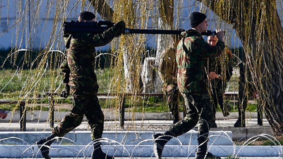 Ukraine orders troops out of Crimea