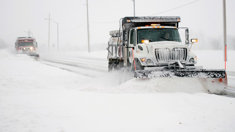 Snowfall records smashed as monster Midwest storm heads east