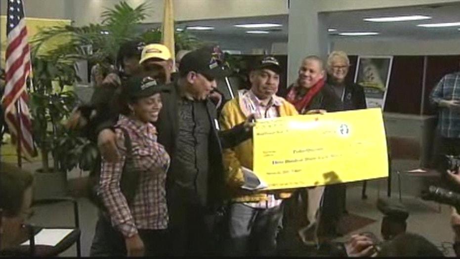 Pedro Quezada Collects $338M Powerball Check