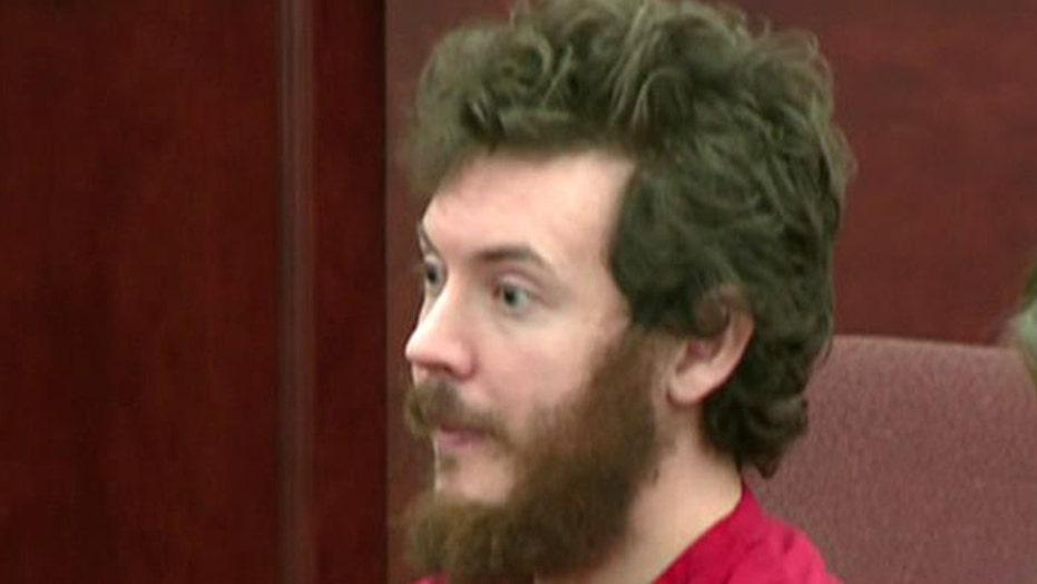 Prosecutors seek death penalty for movie massacre suspect