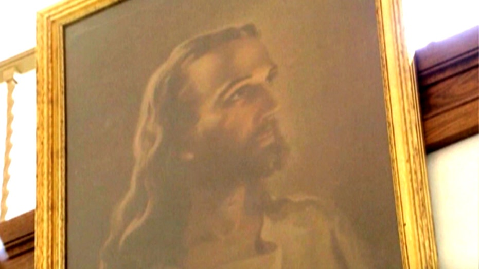 Ohio school takes down Jesus portrait under legal threat