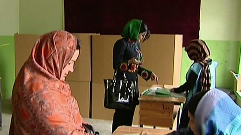 Afghans defy Taliban threats to vote in presidential election