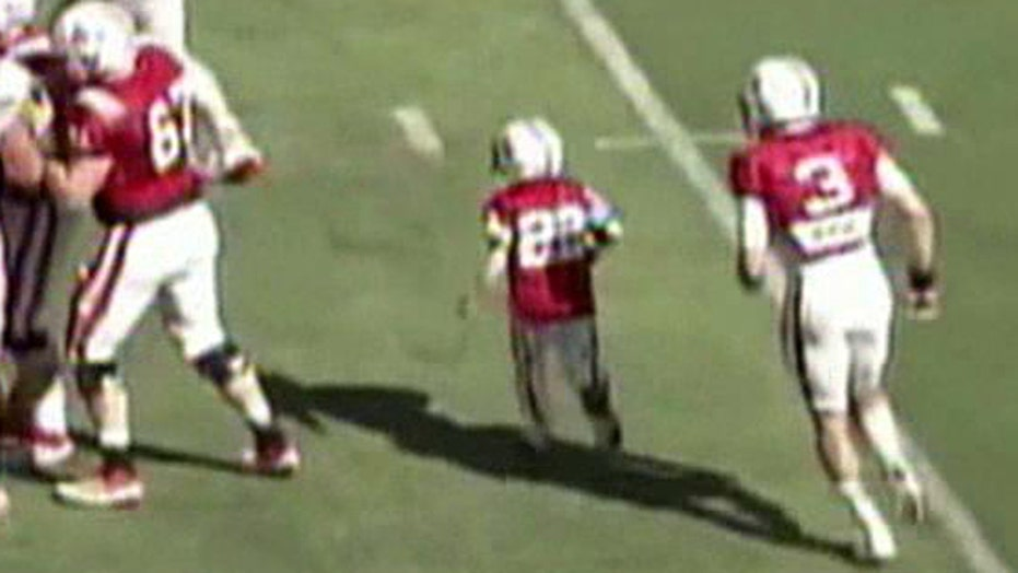 7 year old cancer patient takes the field with Nebraska team