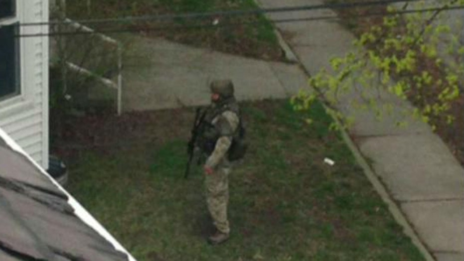 Boston suburbs on lockdown as manhunt continues
