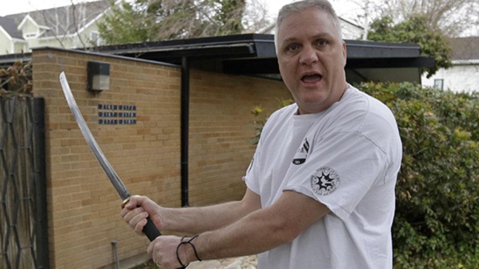 Sword-wielding neighbor confronts attacker
