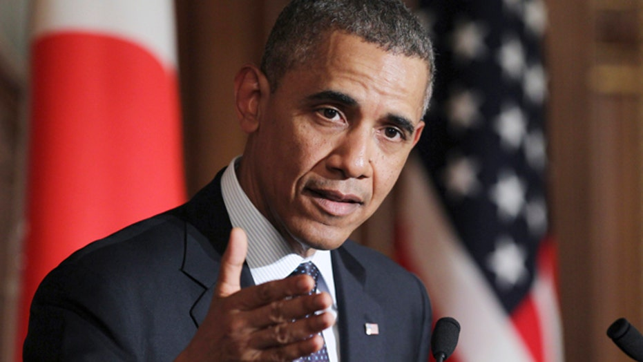 Obama warns of sanctions as Russia threatens Kiev