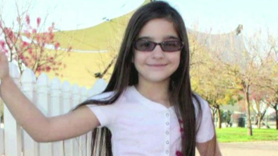 Manhunt for home intruder who fatally stabbed 8-year-old