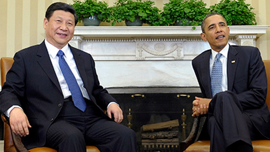 Does China feel threatened by US military boost in Asia?