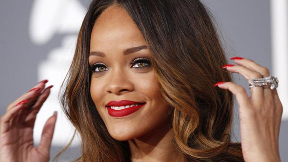 Rihanna takes top off on Twitter