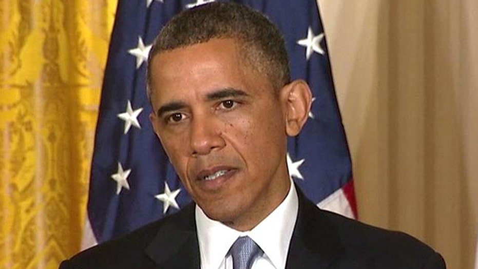 Obama plays defense during press conference