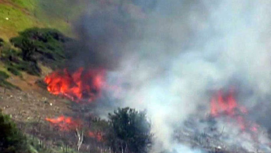 Firefighters gain ground on wildfires