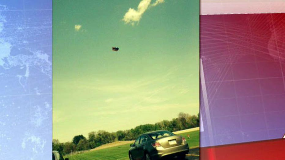 Bounce house blows away, seriously injuring two