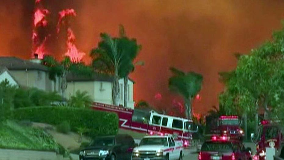 Hundreds of firefighters battle raging wildfires