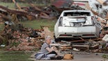 Tornado-wracked residents seek shelter as search for survivors continues