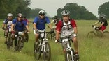 Wounded veterans bike across former president's Texas ranch