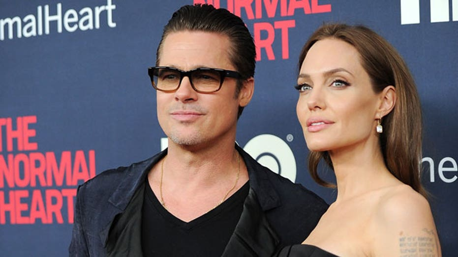Brad Pitt assaulted on the red carpet