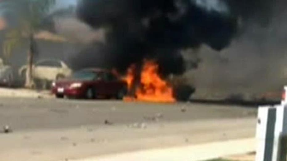 Navy fighter jet crashes and explodes in Calif. neighborhood