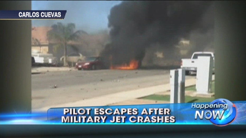 Military jet slams into California neighborhood