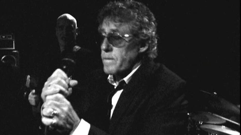 Roger Daltrey rocks out with friend Wilko Johnson
