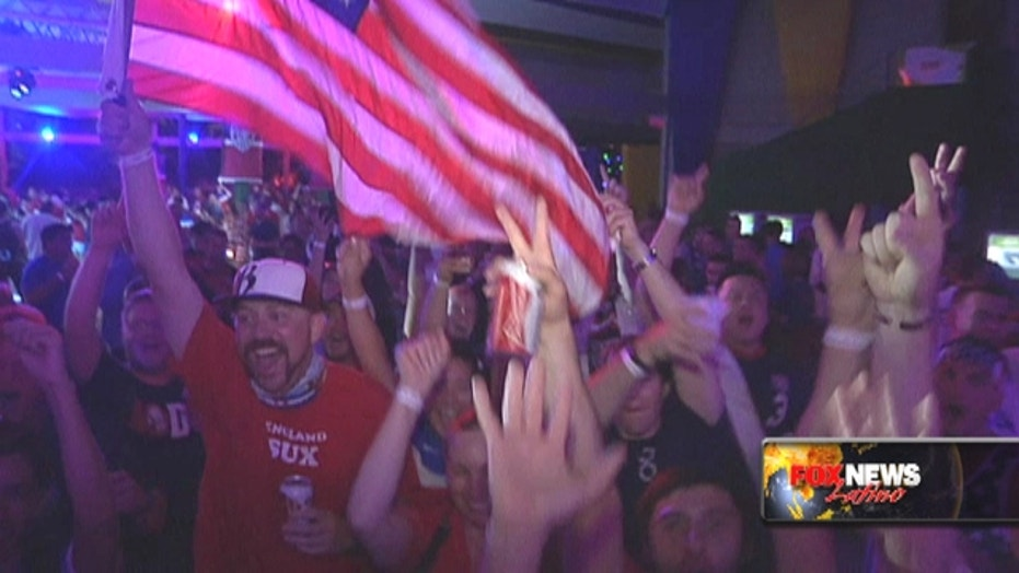USA soccer fans cheer for their team at the World Cup
