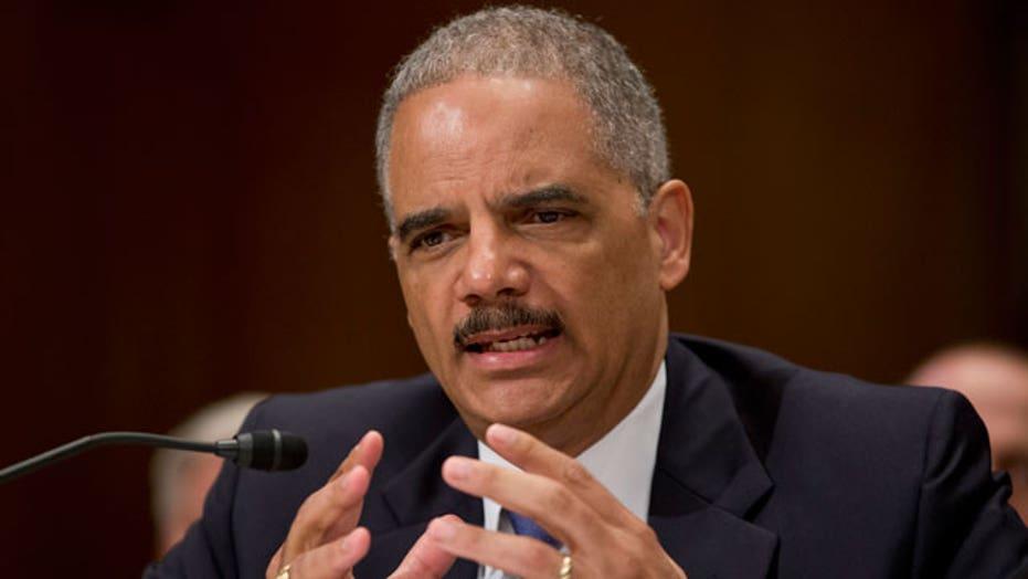 Holder to explain testimony on reporter surveillance