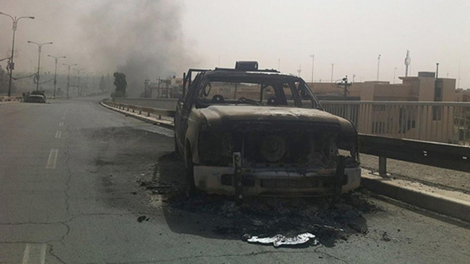 US dismisses air strikes after Iraq's request