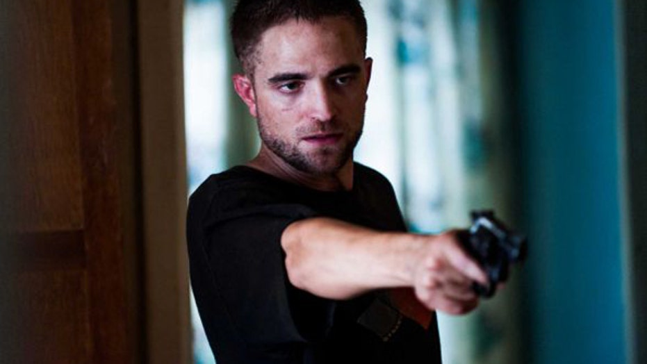 Robert Pattinson takes dark turn