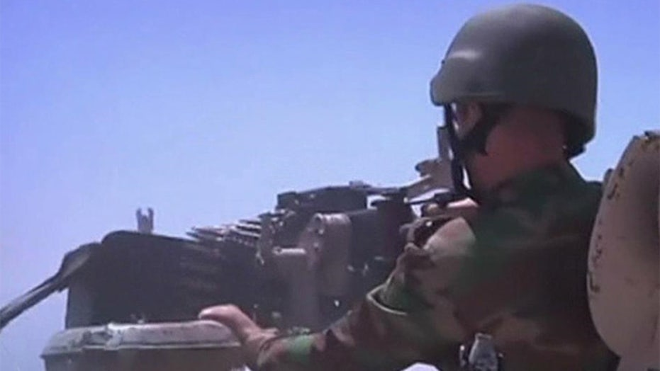Iraq: ISIS seizes control of outposts along Syrian border