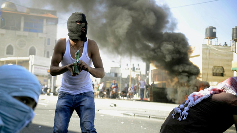 Palestinians clash with Israeli police after body is found