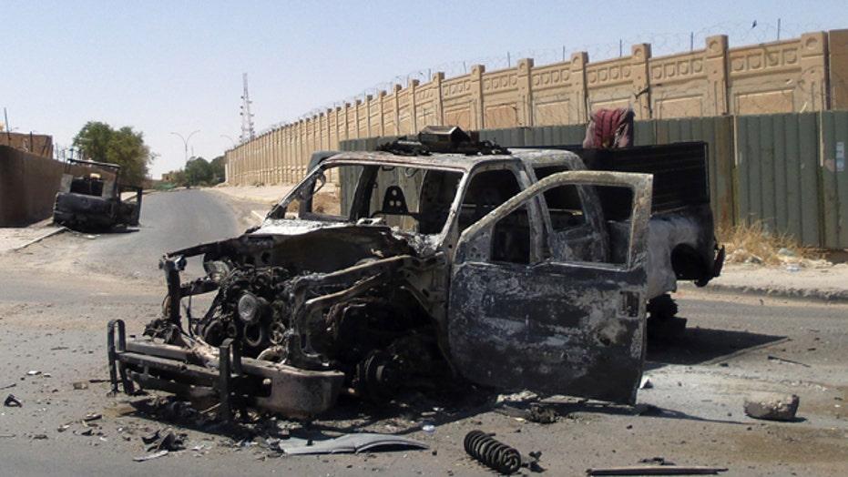 Bias Bash: Media try to shape Iraq crisis
