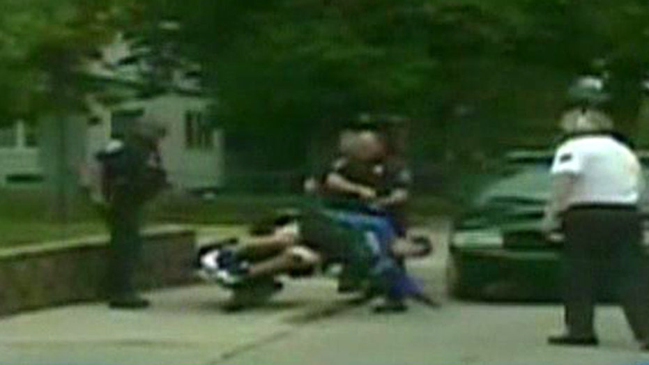Cop to keep his job after knocking man out of wheelchair