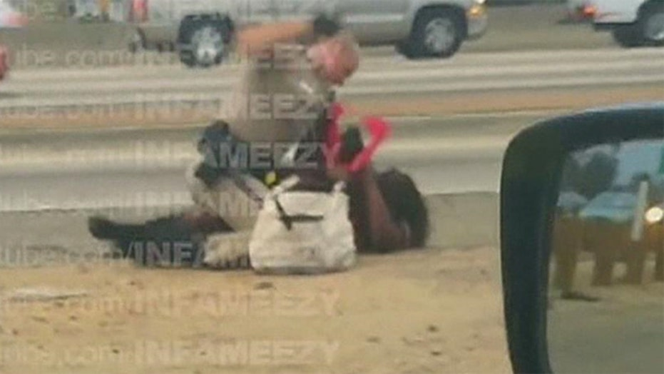 Shocking video of a police officer punching a woman