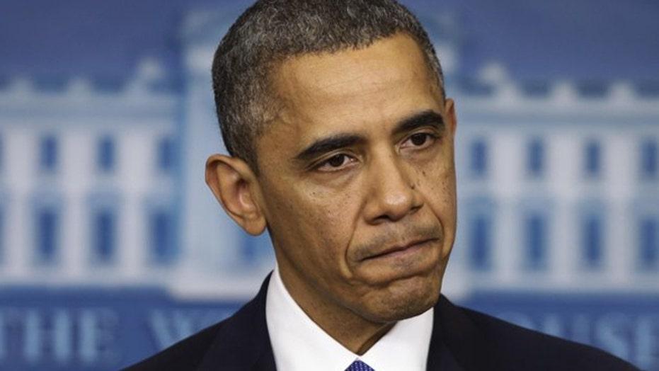 Obama hits press and pundits
