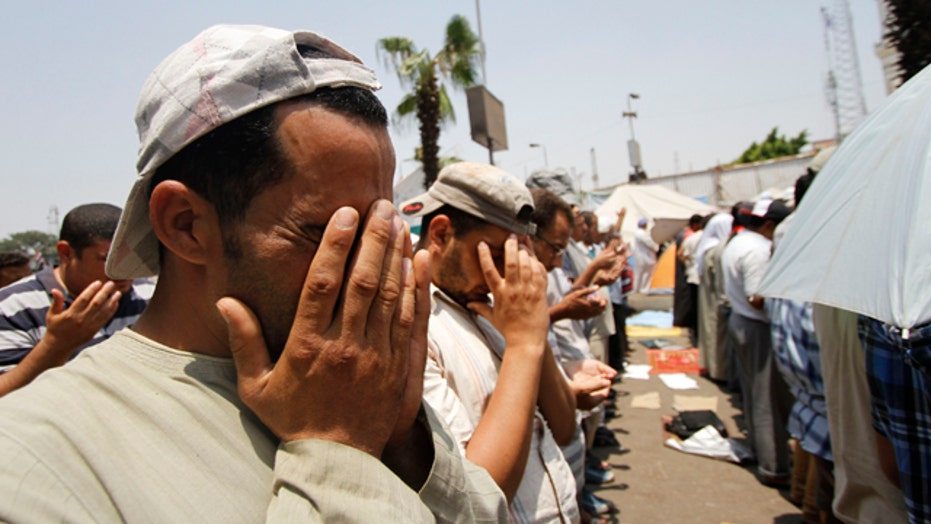 Dozens killed in clash outside military building in Cairo