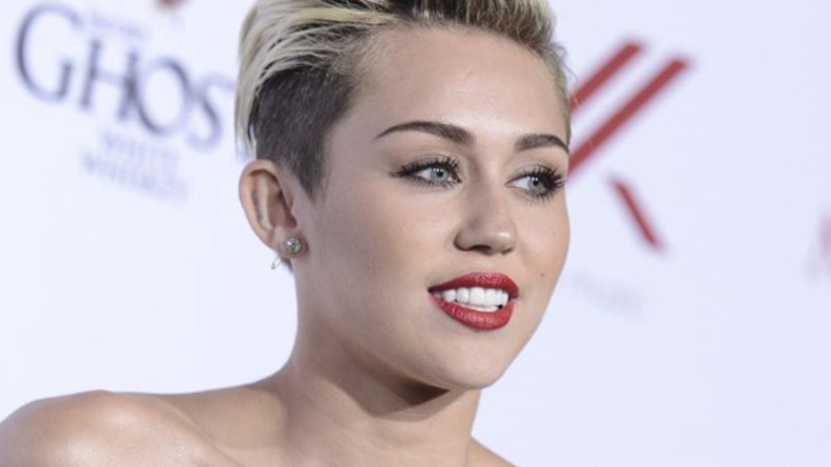 Miley Cyrus going too far in trippy, nude music video?