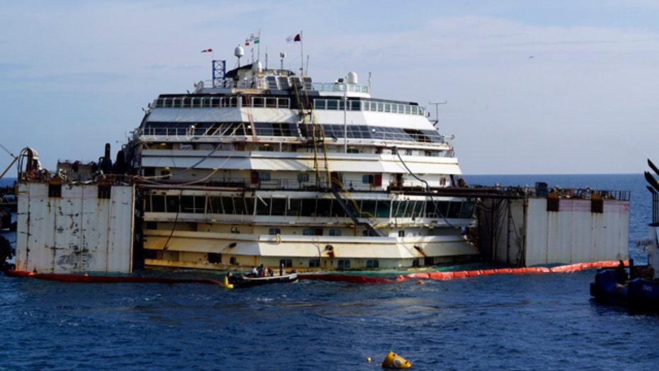 Shipwrecked Costa Concordia refloated